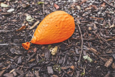 ground-orange-balloon-deflated-large